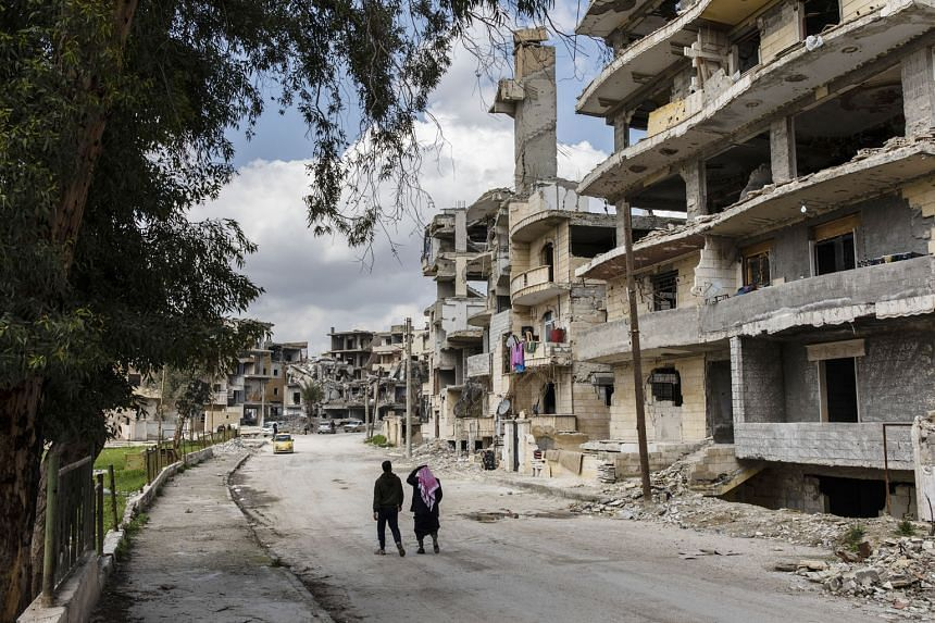 A neighbourhood left heavily damaged by fighting in Syria's Raqqa city. A video featuring ISIS leader Abu Bakr al-Baghdadi seems to confirm the widespread belief that he survived the group's final stand in the battle of Baghouz in the country in Marc