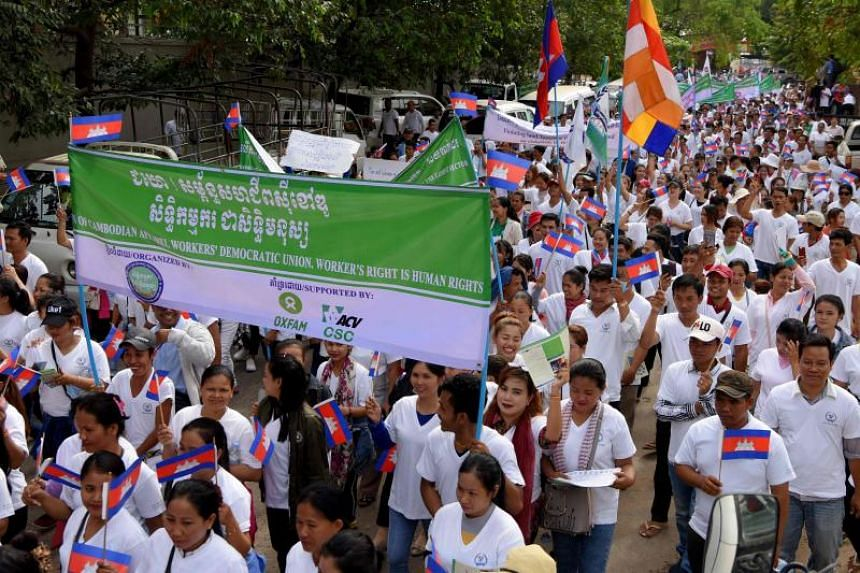 Workers march along a street to mark International Labour Day in Phnom Penh on May 1, 2019.