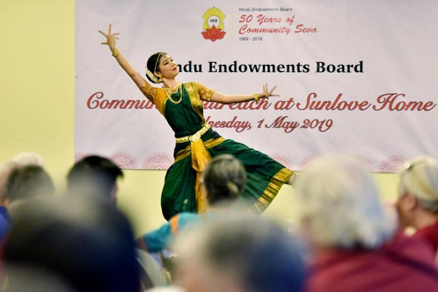 A dancer from dance group Apsaras Arts puts on a performance for the residents at Sunlove Home on May 1, 2019.