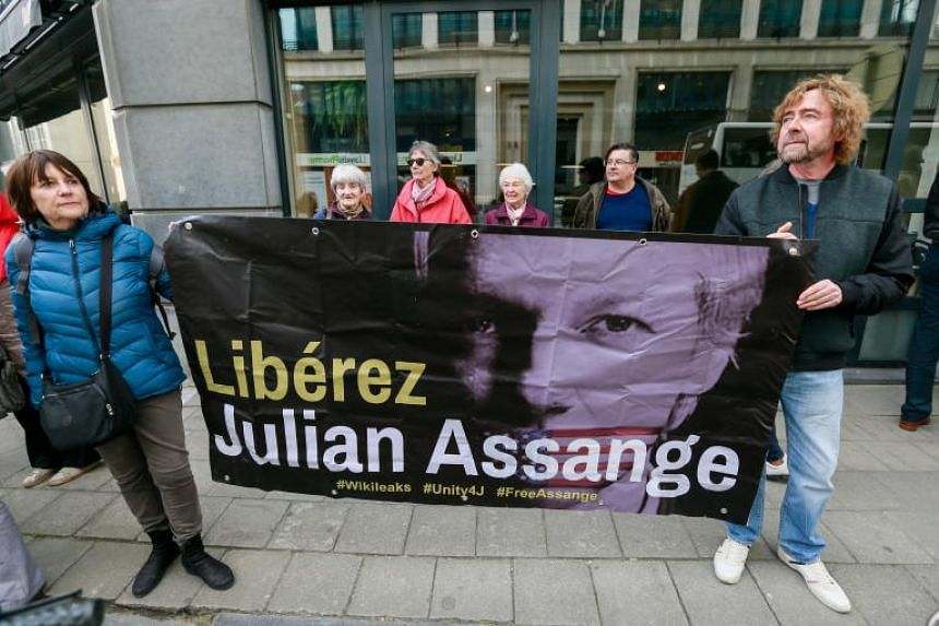 Protesters stand in front of the British Embassy, asking for WikiLeaks founder Julian Assange to be released, Brussels, Belgium, on April 29, 2019.