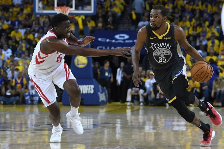 Kevin Durant of the Golden State Warriors (right) drives on Clint Capela of the Houston Rockets in Game Two of the Second Round of the 2019 NBA Western Conference Playoffs at ORACLE Arena on April 30, 2019.