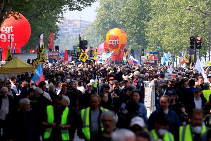 Balloons from the French Trade Union CGT float over the traditional May Day labour union march with French unions and yellow vests protesters in Paris on May 1, 2019.