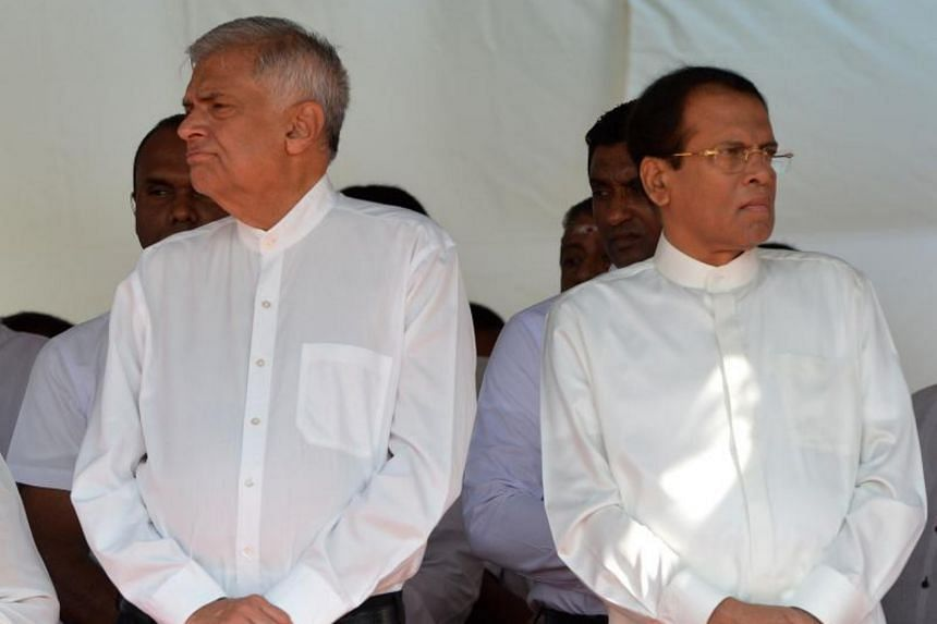 Sri Lanka's Prime Minister Ranil Wickremesinghe (left) and President Maithripala Sirisena attend a commemoration ceremony to mark the 26th anniversary of the assassination of Sri Lanka's then-president Ranasinghe Premadasa in Colombo on May 1, 2019.