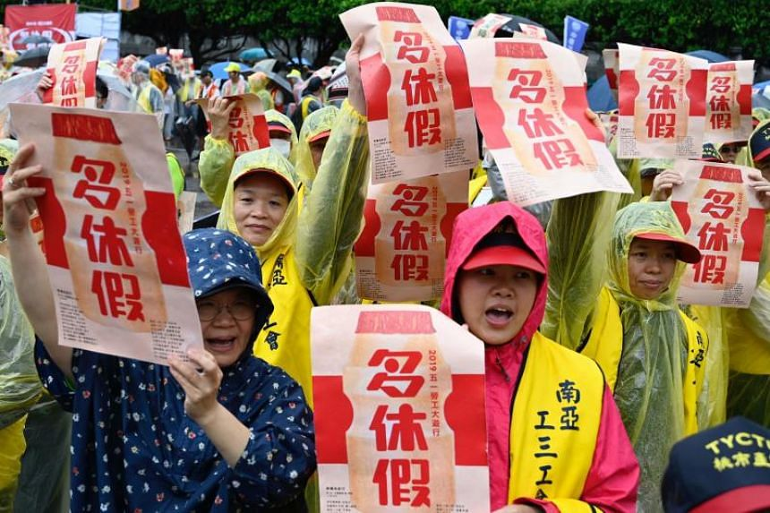 Despite heavy rain, thousands of workers shouted labour rights slogans, marching for hours through the capital of Taipei on May 1, 2019.