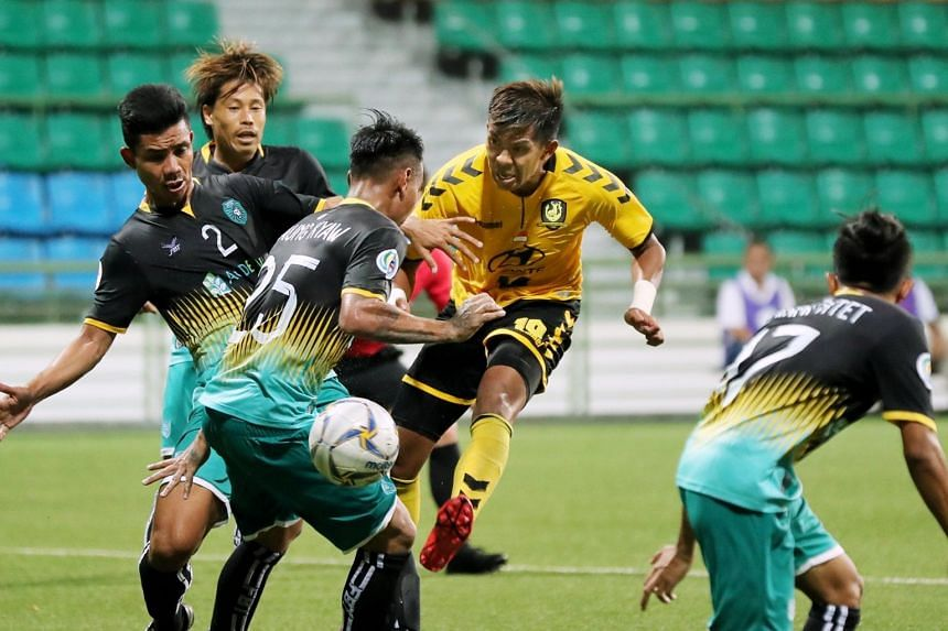 Tampines Rovers' Khairul Amri (centre) tries to kick the ball past Yangon United players in the AFC Cup match at Jalan Besar Stadium on May 1, 2019.
