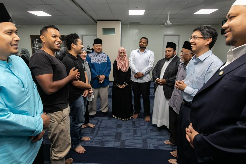 Senior Parliamentary Secretary for Social and Family Development and Education Muhammad Faishal Ibrahim (second from right) talking to wedding solemnisers and couples during the announcement of the the Bersamamu (Malay for With You) programme at the