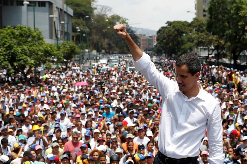 Venezuelan opposition leader Juan Guaido gestures as he speaks to supporters during a May Day rally.