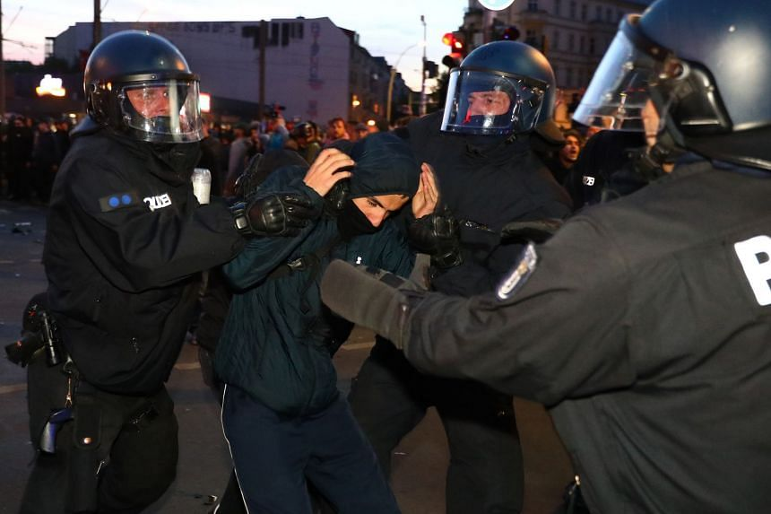 Police detain a protester during the left-wing May Day demonstration in Berlin.