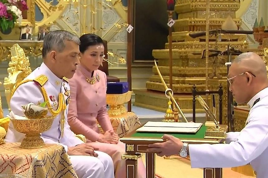 A screengrab from Thai TV Pool video showing King Maha Vajiralongkorn and Ms Suthida Vajiralongkorn Na Ayudhya in their marriage ceremony in Bangkok. Queen Suthida is the King's fourth wife. He has five sons and two daughters from his previous marria