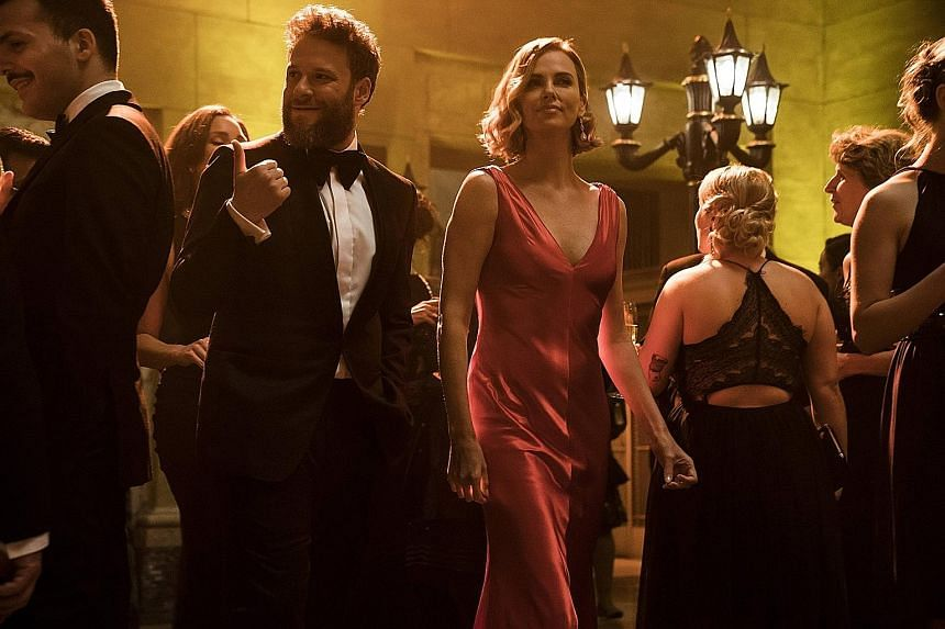 Seth Rogen (left) and Charlize Theron in Long Shot.