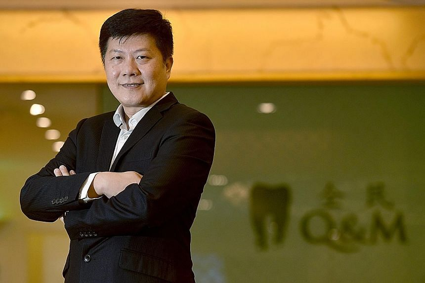 """Dr Ng Chin Siau, chief executive of Q&M Dental Group, plans to help grow the future generations of dentists. """"We are forming the first private dental college in Singapore... It targets graduate dentists who will get an additional diploma from us,"""" he"""