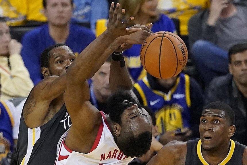 Golden State Warriors forward Kevin Durant (left) and Houston Rockets guard James Harden in a tussle for the ball during Game 2 of their NBA Western Conference semi-final series at Oracle Arena in Oakland on Tuesday. The Warriors won 115-109 to take