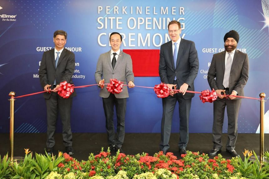 (From left) Dr Prahlad Singh, president and chief operating officer of PerkinElmer; Dr Koh Poh Koon, Senior Minister of State for Trade and Industry; Mr Robert Friel, chairman and chief executive officer of PerkinElmer; and Mr Tajinder Vohra, senior