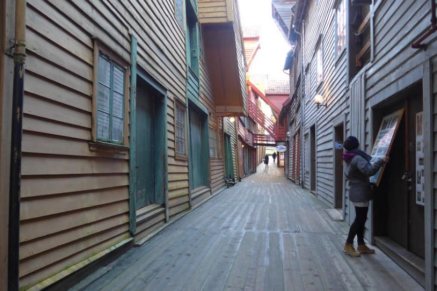 The old wharf of Bryggen in Bergen offers a pleasant wander through harbourfront tenements and narrow red alleys, where the stockfish merchants of yore plied their trade.