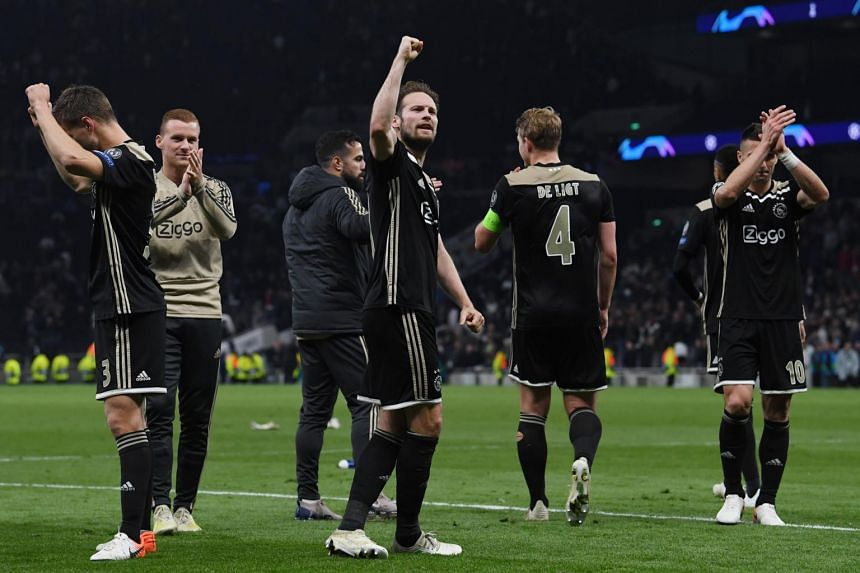 Ajax players applaud fans after the UEFA Champions League semi-final match against Tottenham in London, on April 30, 2019.