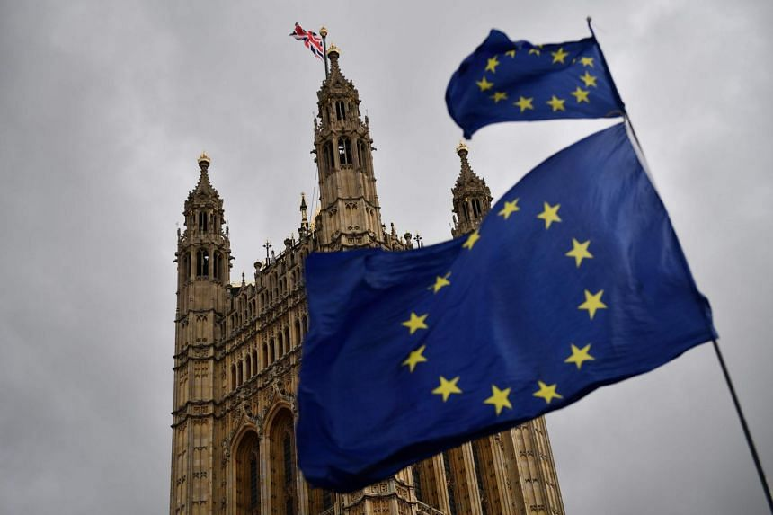 European Union flags held by demonstrators flutter near the Houses of Parliament in central London on April 4, 2019.