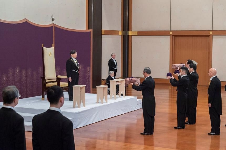 Japan's Emperor Naruhito attends the Kenji to Shokei no gi ritual, at the Imperial Palace in Tokyo on May 1, 2019. With women and underage children ineligible to attend, only two members of the royal family were present - Naruhito's brother Prince Ak