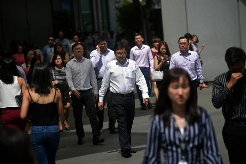 Office workers in Singapore's central business district, on Dec 6, 2018.