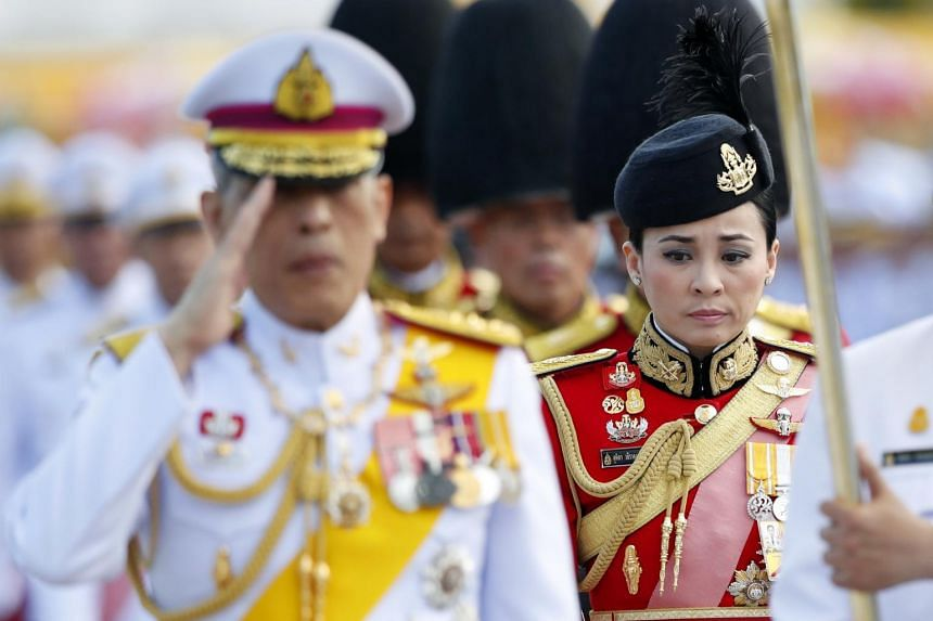 Ms Suthida seen behind King Maha Vajiralongkorn during a royal ceremony in Bangkok, on April 6, 2019.