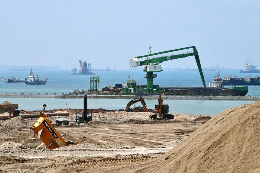 Machines carry out landfilling works on newly reclaimed land at Tuas Terminal Phase 1 on April 18, 2019.