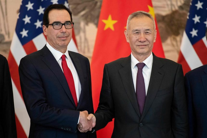 China's Vice Premier Liu He (right) shakes hands with US Treasury Secretary Steven Mnuchin at the Diaoyutai State Guesthouse in Beijing, on March 29, 2019.