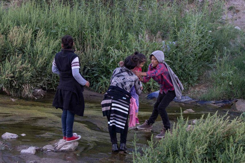 Migrants cross the Rio Grande between Ciudad Juarez, Mexico, and El Paso, Texas, on April 29, 2019.
