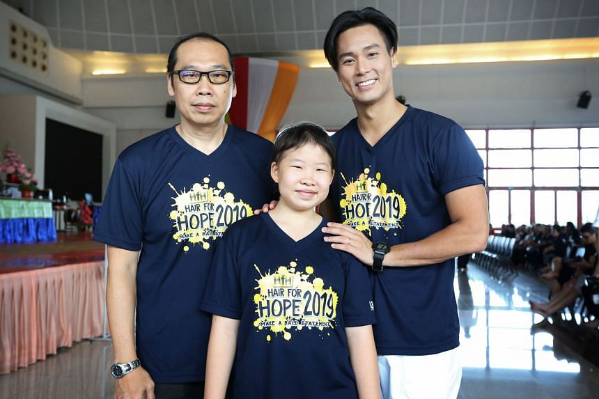 Right: Mr Chong Hui Kwee (left of image), his daughter Joanna and local actor Andie Chen, one of this year's Hair for Hope ambassadors. Far right: Mr Chong and his daughter getting their heads shaved as part of Hair for Hope at Kong Meng San Phor Kar