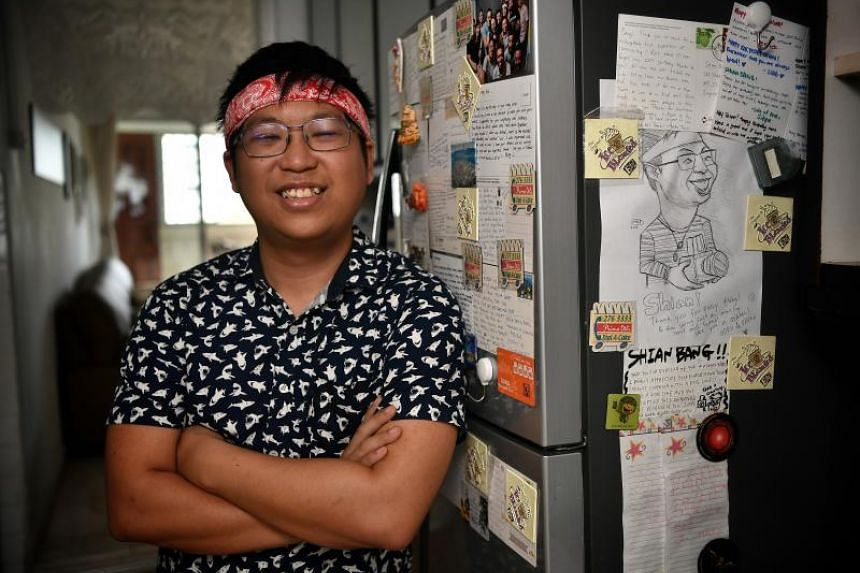 Mr Ngoh Shian Bang, who began hosting backpackers at his Tampines home in 2014, with letters and postcards from his guests.