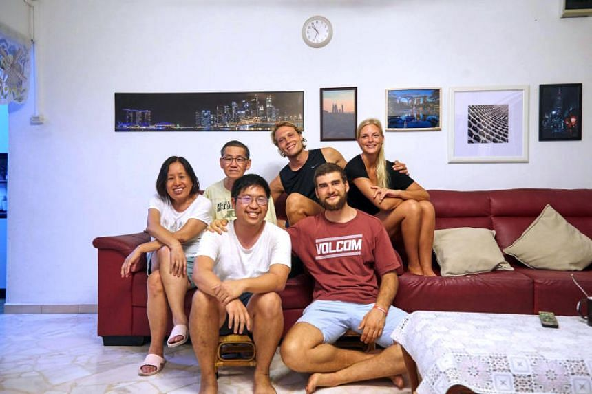 Mr Ngoh Shian Bang (first row, left) with his guests from Finland and Argentina. He compiles a list of free and cheap recommendations for his guests, who are often travelling on a budget.