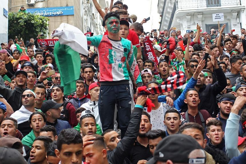 Algerian protesters shout slogans during a demonstration in the capital Algiers on May 3, 2019.