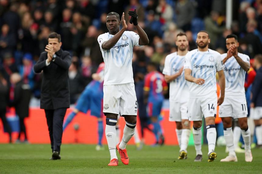 Everton's Kurt Zouma applauds fans after the match against Crystal Palace in London, on April 27, 2019.