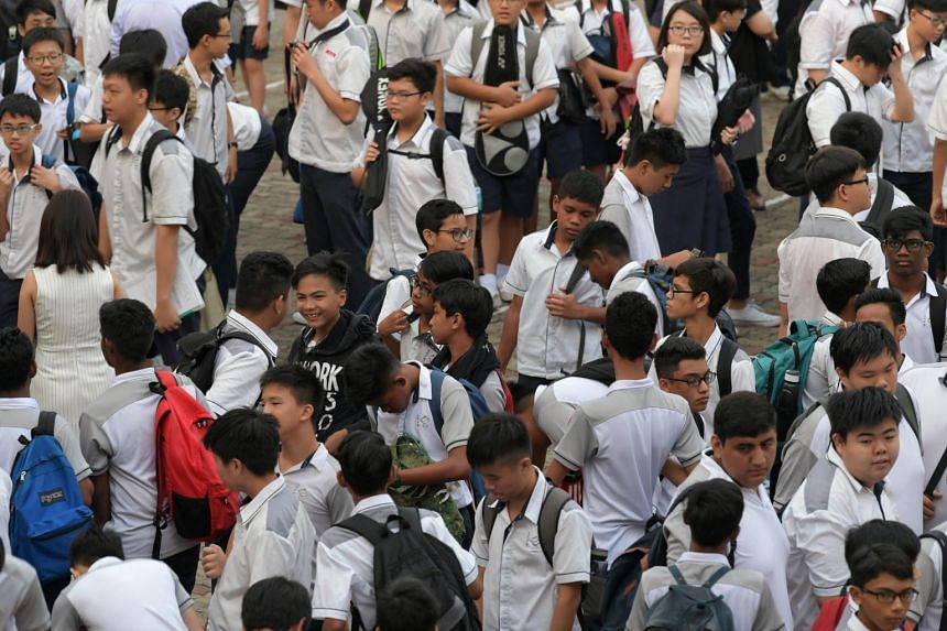 Secondary School students leaving the school's parade square after assembly.