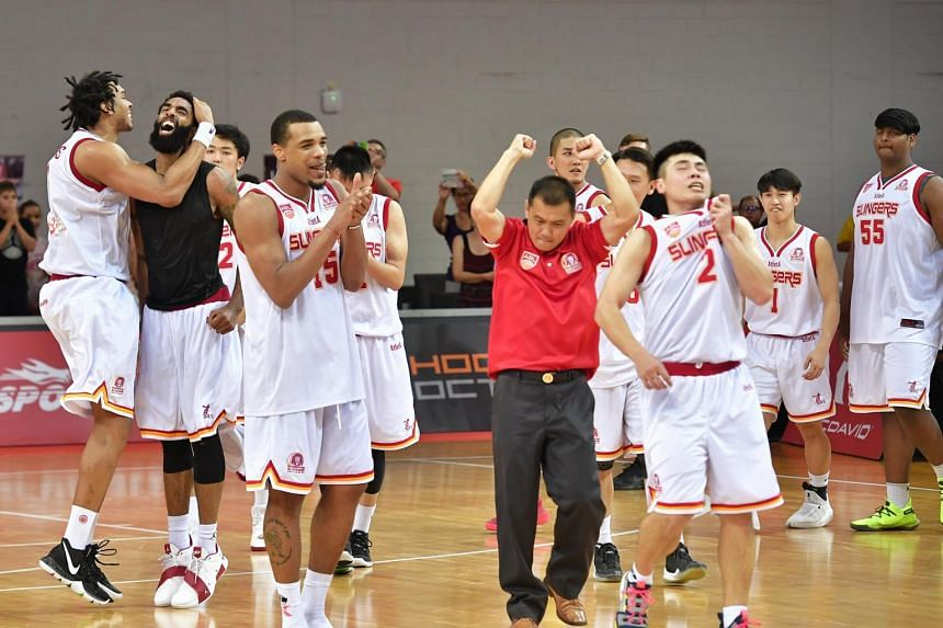 Singapore Slingers celebrating after beating Macau Black Bears 81-79 in the third quarter-final match at the OCBC Arena on April 7, 2019 .