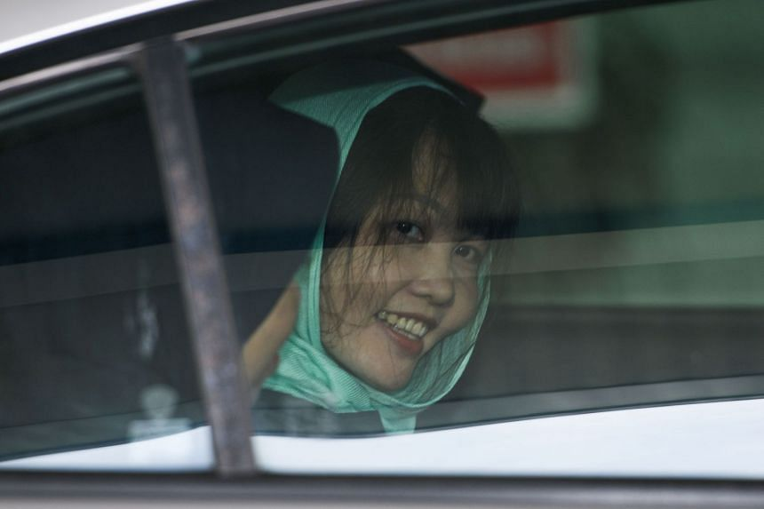 Doan Thi Huong smiles as she is escorted from the High Court in Shah Alam on April 1, 2019.