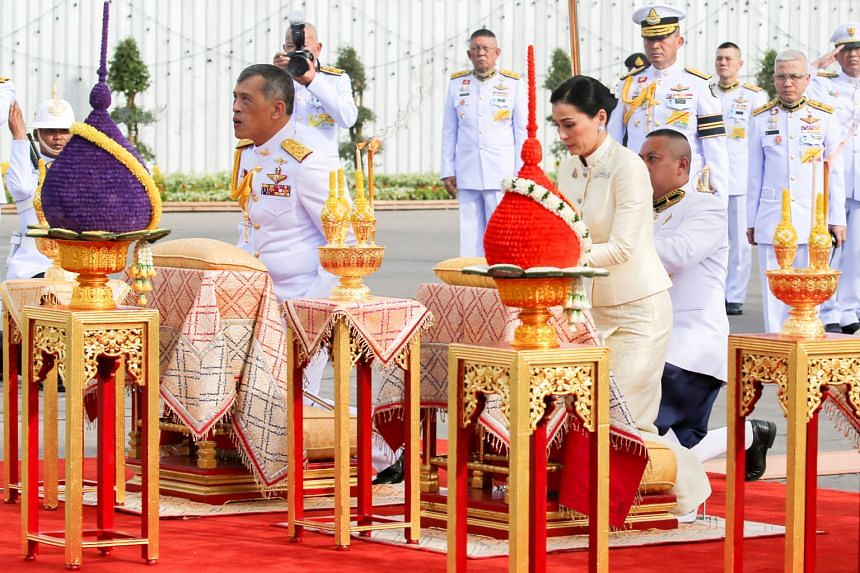 Thailand's King Maha Vajiralongkorn and Queen Suthida paying their respects before the statue of King Rama V at the Royal Plaza in Bangkok yesterday. The monarch's coronation which takes place from tomorrow to Monday will be the first the coun
