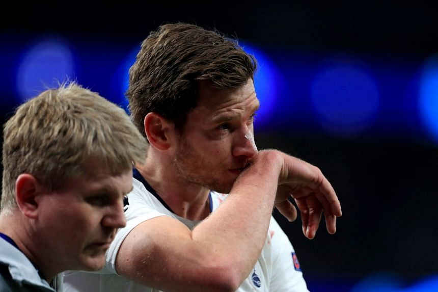 Vertonghen (right) walks off the pitch injured.