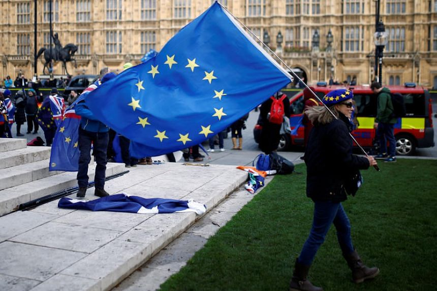 Anti-Brexit demonstrators protesting outside the Houses of Parliament in London on April 9, 2019.