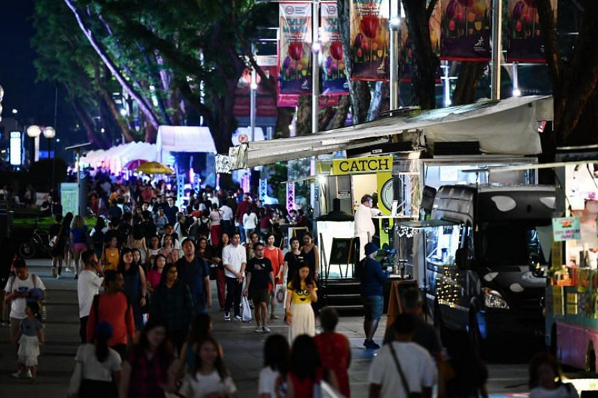 Food trucks along Orchard Road for the Night at Orchard pop-up street event.