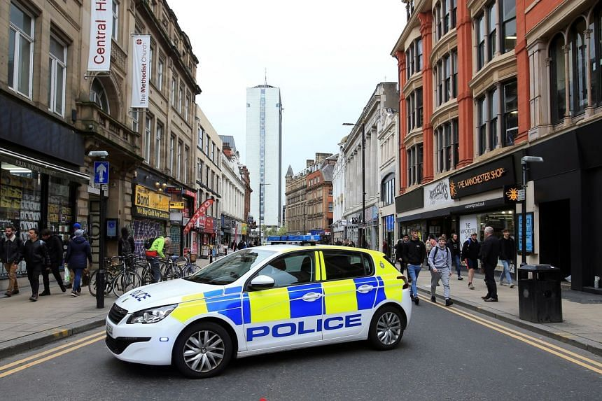 A police car blocks a street close to where a suspect package was found in Manchester.