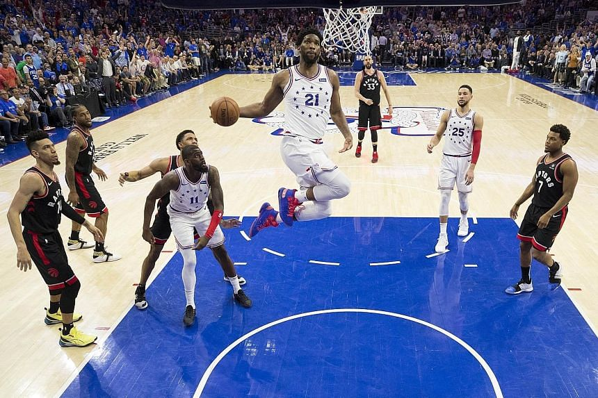 Joel Embiid of the Philadelphia 76ers about to dunk the ball in the game against the Toronto Raptors on Thursday. PHOTO: AGENCE FRANCE-PRESSE