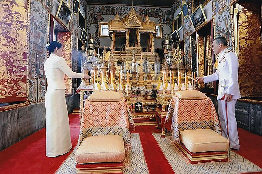 A Thai Royal Household Bureau photo showing King Maha Vajiralongkorn and Queen Suthida paying their respects at the Bangkok City Pillar Shrine on Thursday. As the wife of Thailand's ruler - who is reportedly the world's richest monarch with assets of