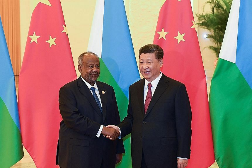 Chinese President Xi Jinping welcoming Djibouti's President Ismail Omar Guelleh at the Great Hall of the People in Beijing on April 28. China currently has just one overseas military base, in Djibouti.