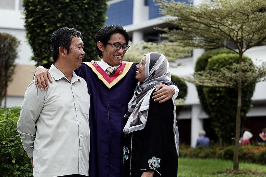 Lee Kuan Yew Award winner Shahreyll Khairoullah with his parents, Mr Khairoullah Shamsurie and Madam Aishah Mohamed, after his graduation ceremony at Nanyang Polytechnic yesterday.