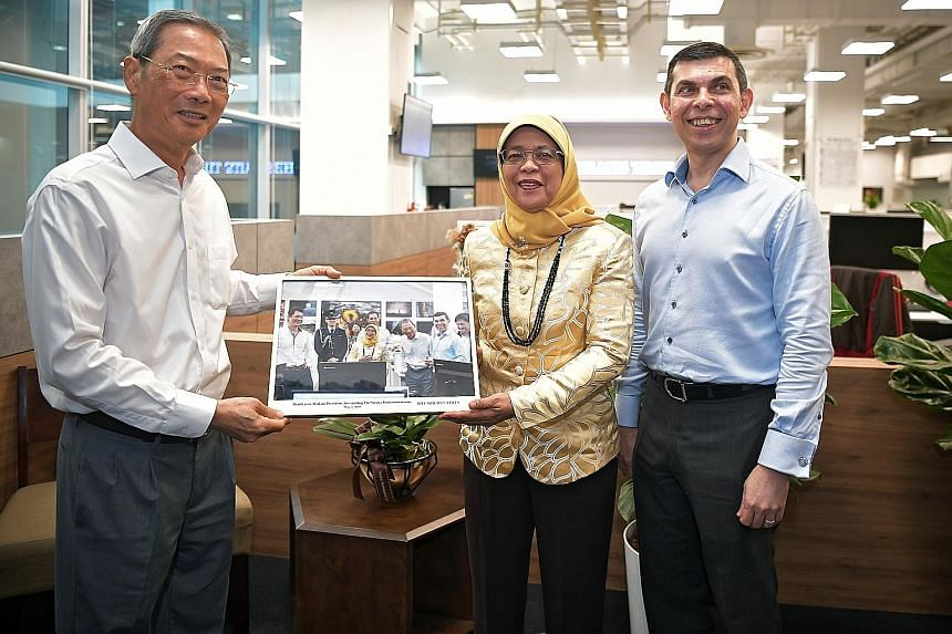 (From right) SPH deputy chief executive officer Anthony Tan, ST editor Warren Fernandez and SPH chairman Lee Boon Yang showing President Halimah Yacob the revamped ST newsroom yesterday. With them are (from left) ST associate editor Paul Jacob; Mr Eu