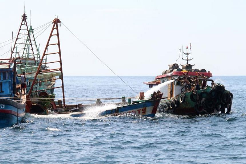 Indonesian authorities sinking a Vietnamese fishing boat at Datuk island in West Kalimantan, on May 4, 2019.