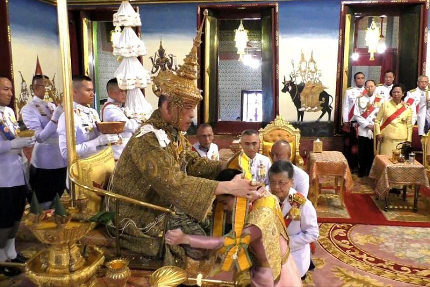 Screengrab from a television broadcast showing Thailand's King Maha Vajiralongkorn and Queen Suthida at the coronation ceremony in Bangkok.