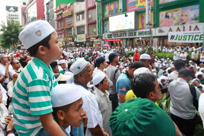 "Particiapants at the rally in Kuala Lumpur to defend the ""sovereignty of Islam""."
