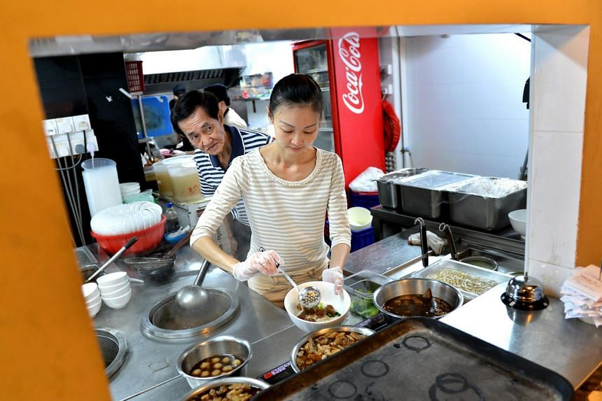 Miss Tina Tan and her father, Mr Anthony Tan, the third-generation owner of Hock Lam Beef. Miss Tan, the middle child of the family, decided to take over the beef noodles business as she could not bear seeing her family's legacy go down the drain.