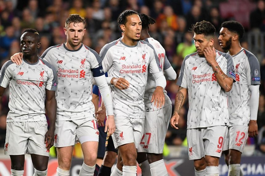 Liverpool players react during the UEFA Champions League semi-final first leg football match between Barcelona and Liverpool at the Camp Nou Stadium in Barcelona, on May 1, 2019.