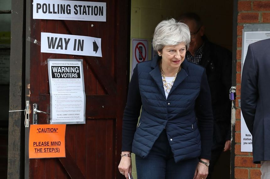 Prime Minister Theresa May leaving after casting her vote on Thursday. She said the early results were a message from voters to deliver Brexit.